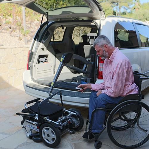 Eloflex hopfällbar elrullstol kran lasta in i bilen